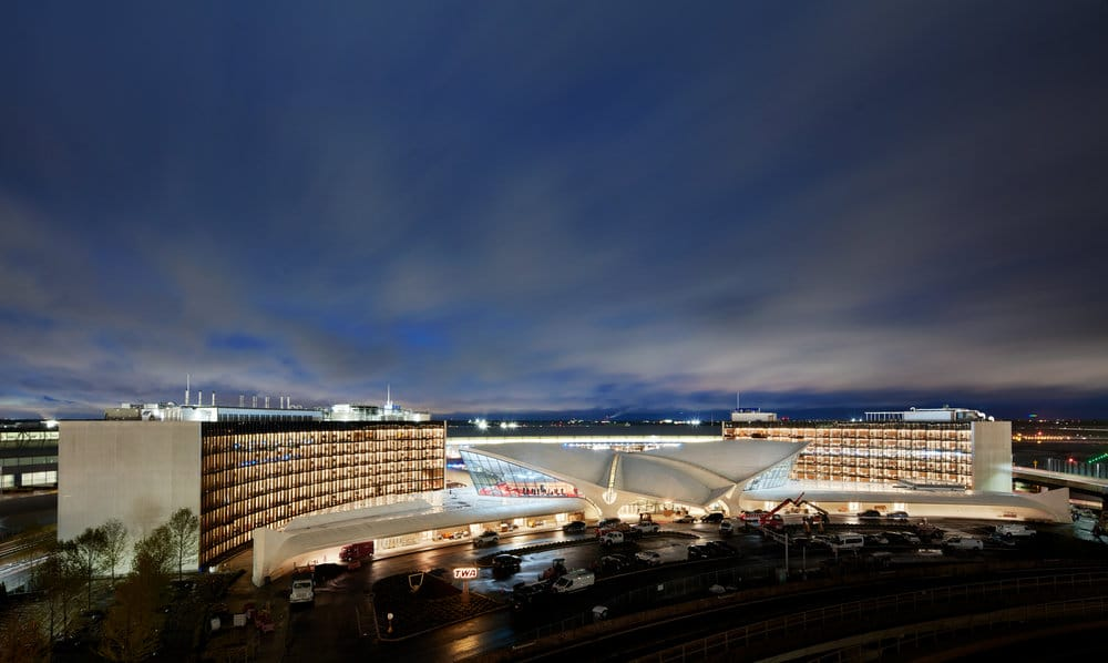 TWA Flight hotel. A large white building shot at night.