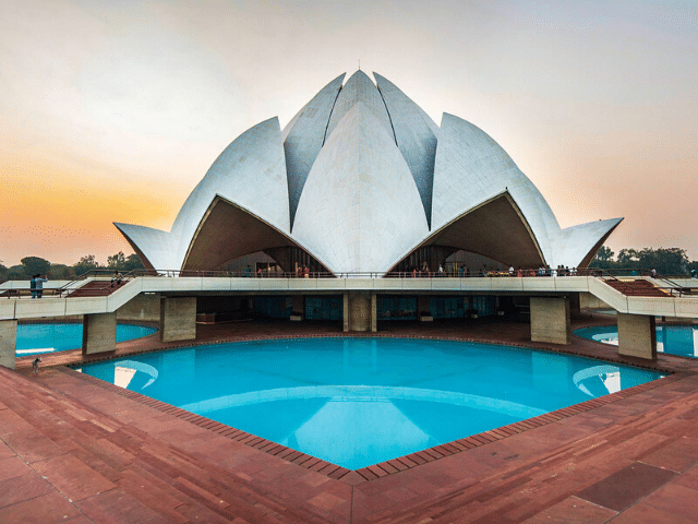 The Lotus Temple. A petaled white building.