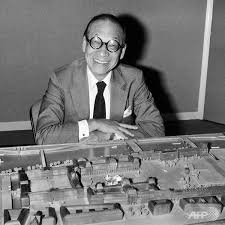 A black and white portrait of Ieoh Ming Pei sitting in front of one of his architecture models.