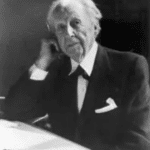 A portrait of Frank Lloyd Weight in black and white. He is older and wearing a suit.