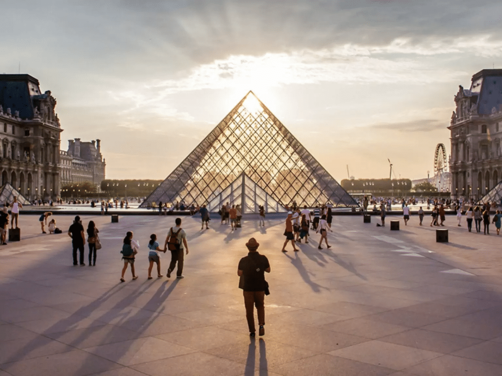 Photo of the Louvre with the sunlight coming through the glass pyramid.